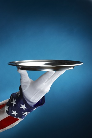 Close up shot of uncle sam holding empty silver tray with space for copy
