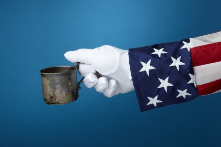 Uncle Sam with cup in hand looks for money Stock Photo