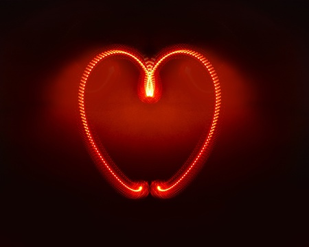 Heart produced with moving red light shot in studio, includes space for romantic copy