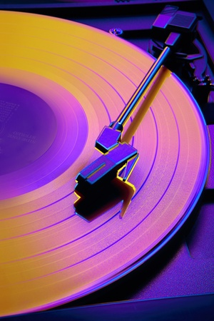grooves: Close up of record player with altered colors shot in studio Stock Photo