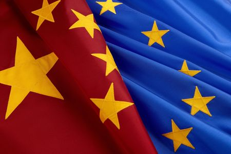 Chinese and European Union flags shot together, close-up