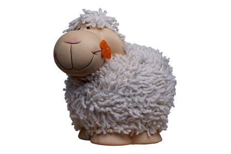 objec: porcelain and woolen toy sheep with orange flower in the mouth  Stock Photo