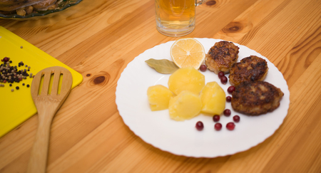 wiener: Wiener schnitzel and boiled potatoes with sliced lemon Stock Photo