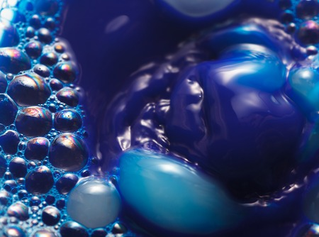 Water surface with blue bubbles abstract background