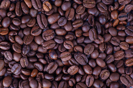 Roasted coffee beans, texture coffee background. Close-up