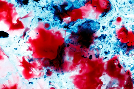 vesicles: Wax blurs in water. Abstract red and blue background