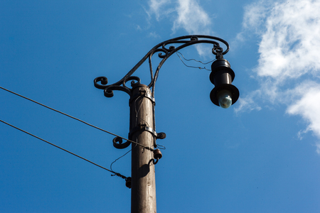 Vintage street lamp on blue sky background