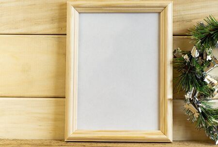 Christmas mock-up of wooden frame for photos