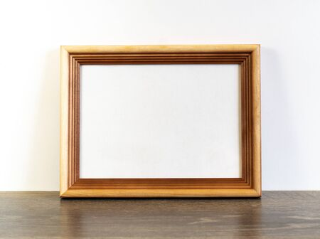 Frame mockup with horizontal wooden frame on white wall background Imagens