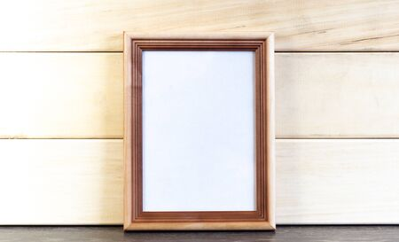 Vertical Dark Brown Picture Frame on Wooden Planks Background