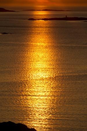Deep golden reflection across the water Stock Photo - 13367614