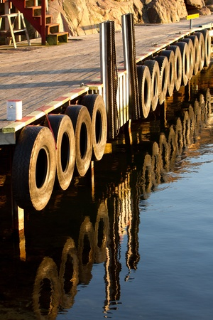 refelction: Boat mooring and wooden walkway with refelction Stock Photo