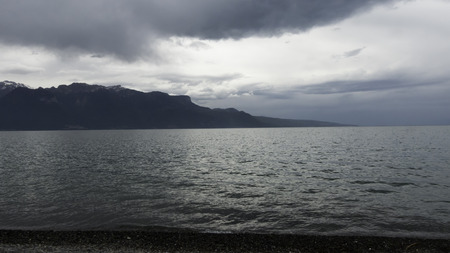 mistery: Mountain with the lake in a cloudy day Stock Photo