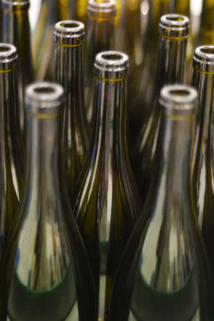 shallow  focus: Wine bottles shallow focus blurred foreground defocused background bokeh light sun flares. Stock Photo