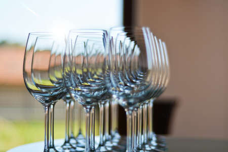 shallow  focus: Wine glasses shallow focus blurred foreground defocused background bokeh light optical refraction.