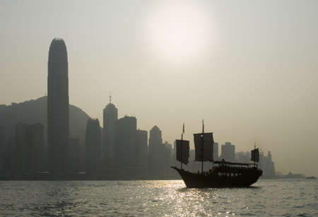 victoria harbor: Sunset view on Hong Kong Islands famous skyscrapers seen from Victoria Harbor with a boat in the foreground