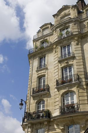 archetypal: Architectural details of an Art Nouveau facade of a building on Ile de La Cit�, with its balconies, archetypal street light, chimneys and classical style