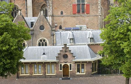 annexed: The details of the East Facade of the Bavo Church in Haarlem the Netherlands, with the vicars lodge in front
