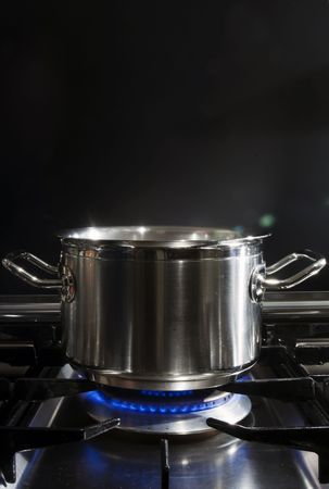 A stainless steel pan on a stove photo