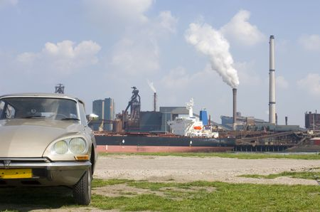 steel works: A car contrasting with the steel works in the rear.
