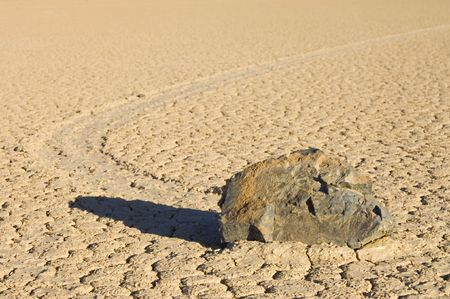 The phenomenon of the moving rocks at the race track playa of Death Valley National Park photo