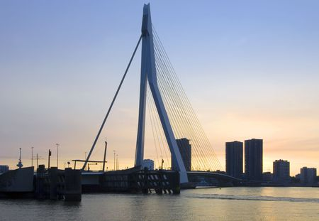 euromast: The Erasmus Bridge in Rotterdam, the Netherlands during a vibrant sunset