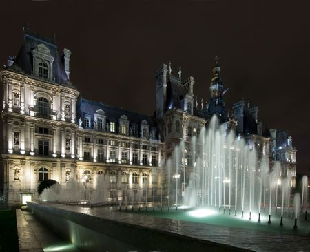 The lit fountains in front of the Hotel de Ville in Paris at night, nicely illuminated to show the  photo