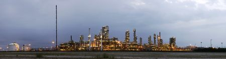 A 22 stitched image panoramic of a petrochemical plant at a grey, gloomy dawn