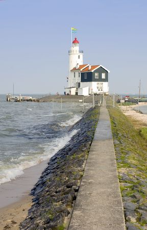 elevated walkway: The famous lighthouse at the east point of the peninsula of Marken, called