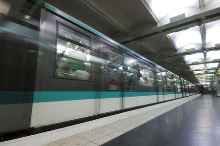 gradually: A metro leaving a subway station, gradually accellerating