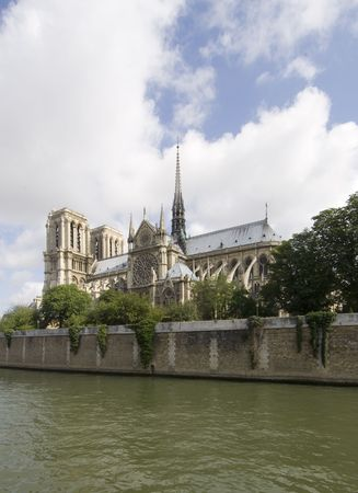 archetypal: A classic, almost archetypal view of the Notre Dame and Ile de la Cit�, seen from across the river Seine in Paris. The cathedral is basking in the sunlight Stock Photo