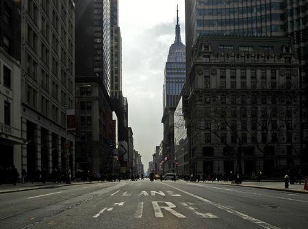 new york street: Fifth Avenue on st. Patricks Day. The empty firelane in a backlit scene