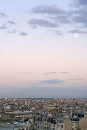 highrises: The setting sun over suburban Paris, France, seen from Mont Martre. The last rays of sunlight reflecting in the high-rises in the distance