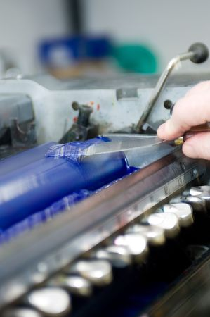 offset printing: Applying ink on the reels of an offset printing press Stock Photo