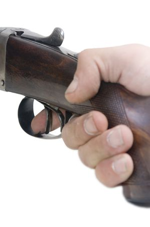 finger on trigger: The index finger on the trigger of a shotgun, ready to fire Stock Photo