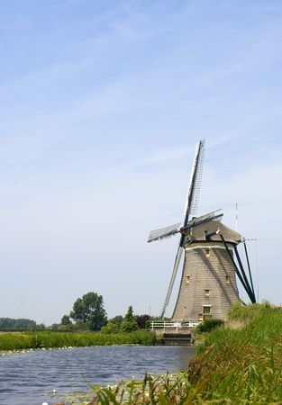 watermanagement: A typical Dutch Windmill, used for water management to keep the polders dry near Leidschendam, The Netherlands Stock Photo
