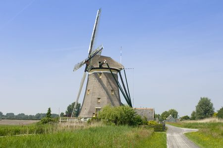 archetypal: An archetypal Dutch windmill in Leidschendam on a nice spring day.