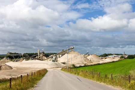 sand quarry: The entrance of a sand and cement quarry Stock Photo