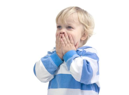 3 year old: A 3 year old caucasian boy, covering his mouth with his hands in total surprize.