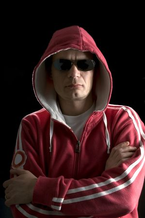 hoodlum: A grim looking Hoodlum wearing sunglasses Stock Photo
