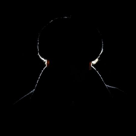 frontal portrait: A grim looking silhouette of a Soviet guard