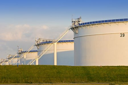 Oil storage tanks in the evening light Stock Photo
