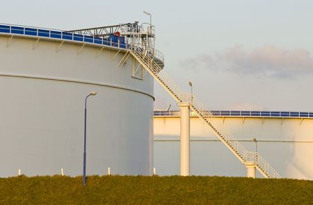 Oil tanks in the warm glow of the evening light Stock Photo - 2546927