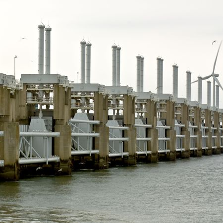 watermanagement: Seagulls surrounding the high tech water management and protection structure of the Oosterschelde Storm flood barrier Stock Photo