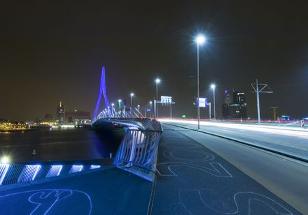 The famous Erasmus Bridge, approaching the steps leading to the boardwalk. The steps have drawings in chalk on them Stock Photo - 2557983