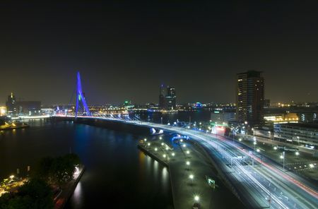 The Rotterdam Skyline with the famous Erasmus Bridge over the river Meuze at night photo