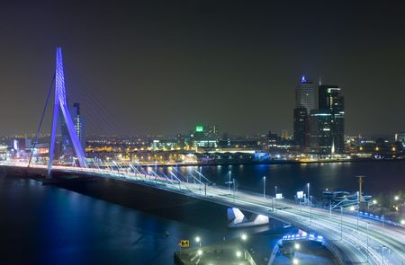 maas: The Rotterdam Skyline with the famous Erasmus Bridge over the river Meuze at night
