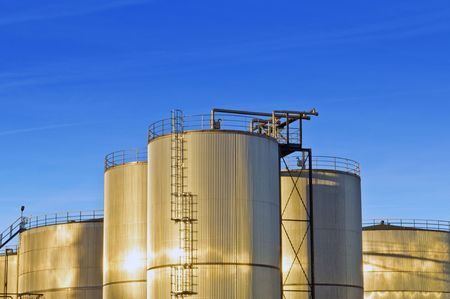 An industrial plant with huge stainless steel silos, reflecting in the evening sun Stock Photo - 2613977
