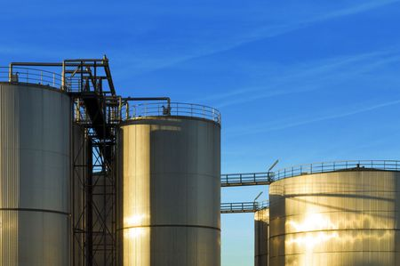 An industrial plant with huge stainless steel silos, reflecting in the evening sun Stock Photo - 2613973