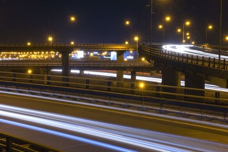 flyover: Traffic on an Highway Over pass or fly-over with motionblurred head lights Stock Photo